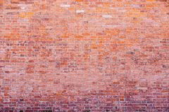 Old stone wall from a natural brick of red color Royalty Free Stock Image