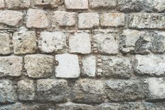 Old stone wall, old texture of natural color authentic stones blocks closeup.Background of stone wall texture. Old stone wall, old texture of natural color royalty free stock images
