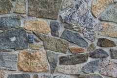 Old stone wall with outlet Stock Image