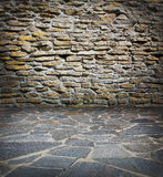 Old stone wall and pavement Royalty Free Stock Photo