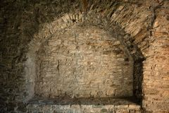 Old stone wall. Recess frame in old stone wall Royalty Free Stock Photography