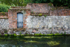 Old stone wall on river Royalty Free Stock Images