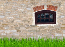 Old stone wall with a small window Stock Image