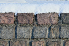 Old stone wall in the snow Royalty Free Stock Image