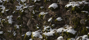Old stone wall with snow Stock Photo