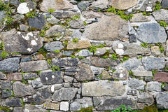 Old stone wall with some moss Stock Photo
