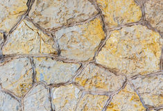 Old stone wall. Stonework of sandstone. Stock Photography