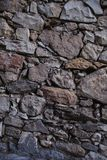 Old stone wall texture and background. Rock wall background. Abstract texture and background for designers. Close up view of old stone wall texture and Stock Image