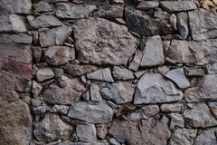 Old stone wall texture and background. Rock wall background. Abstract texture and background for designers. Close up view of old stone wall texture and Royalty Free Stock Image