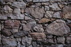 Old stone wall texture and background. Rock wall background. Abstract texture and background for designers. Close up view of old stone wall texture and Royalty Free Stock Photography