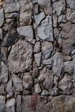 Old stone wall texture and background. Rock wall background. Abstract texture and background for designers. Close up view of old stone wall texture and Royalty Free Stock Photo