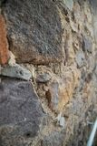 Old stone wall. Texture of the old stone wall, Chora, Greece Royalty Free Stock Photo