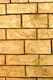 Old stone wall. Texture of the old yellow wall stone as background Stock Photography