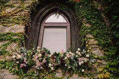 Old stone wall with a wedding decorated window Stock Images