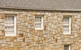Old Stone Wall with White Windows Stock Photography
