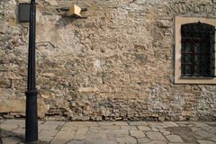 Old stone wall with a window Royalty Free Stock Photo