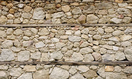 Old stone wall with wooden beams Stock Image