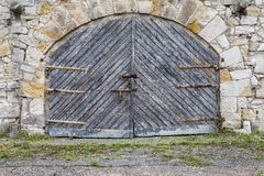 Old stone wall and wooden gate Royalty Free Stock Photography