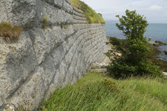 Old stone walls with sea in background. The Nothe fort. Royalty Free Stock Images