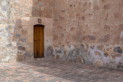 Old stone walls and wooden door Stock Photography