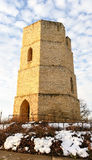 Old stone water tower in winter Royalty Free Stock Image