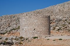 Old stone windmill, Halki island Stock Photography