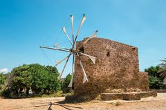 Old stone windmill near the monastery Toplou royalty free stock photo