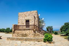 Old stone windmill near the monastery Toplou, Crete royalty free stock photos