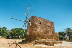 Old stone windmill near the monastery Toplou royalty free stock photos