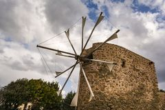 Old stone windmill near Toplou monastery in Crete, Greece royalty free stock image