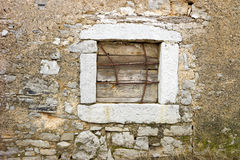 Old stone window with iron Royalty Free Stock Photography