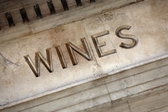 Old stone wine cellar or store sign, vineyard entrance Royalty Free Stock Photo