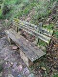 Old stone and wood bench. In the mountain royalty free stock photography