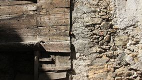 Old Wooden And Stone Walls. Old stone and wooden walls in historic old town. Tirano Italy royalty free stock photography