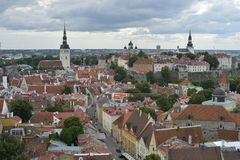 Old stoned streets, houses and red roofs of old Tallinn in the summer day. Stock Photo