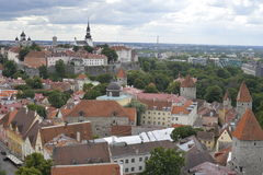 Old stoned streets, houses and red roofs of old Tallinn in the summer day. Stock Image