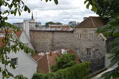 Old stoned streets, houses and red roofs of old Tallinn in the summer day. Royalty Free Stock Image