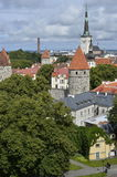 Old stoned streets, houses and red roofs of old Tallinn in the summer day. Royalty Free Stock Photos