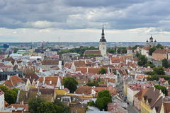 Old stoned streets, houses and red roofs of old Tallinn in the summer day. Royalty Free Stock Photography