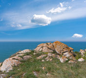 Old stones near sea shore. Landscape with old stones near sea shore Royalty Free Stock Photography