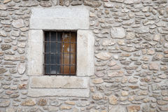 Old stones wall background with a window Royalty Free Stock Image