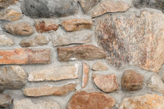 Old stonewall of multicolored granite. Old stone wall of multicolored granite blocks stock photos