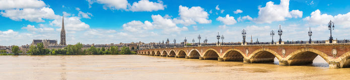 Old stony bridge in Bordeaux. Panorama of Pont de pierre, old stony bridge in Bordeaux in a beautiful summer day, France royalty free stock image