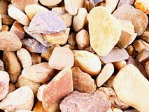 Old stony pavement from natural gravel, dry rounded and colorful pebbles. Stock Images