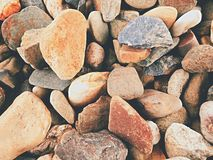 Old stony pavement from natural gravel, dry rounded and colorful pebbles. Royalty Free Stock Photo
