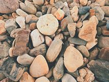 Old stony pavement from natural gravel, dry rounded and colorful pebbles. Royalty Free Stock Photos