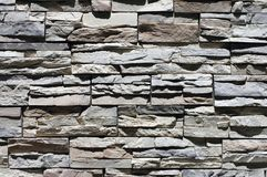 Old stony wall closeup. In the sunshine Royalty Free Stock Photo