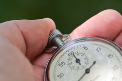 Old stopwatch in hand Stock Photos