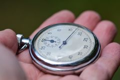 Old stopwatch in hand Stock Images