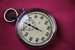 Old stopwatch isolated on black background top view Royalty Free Stock Photo